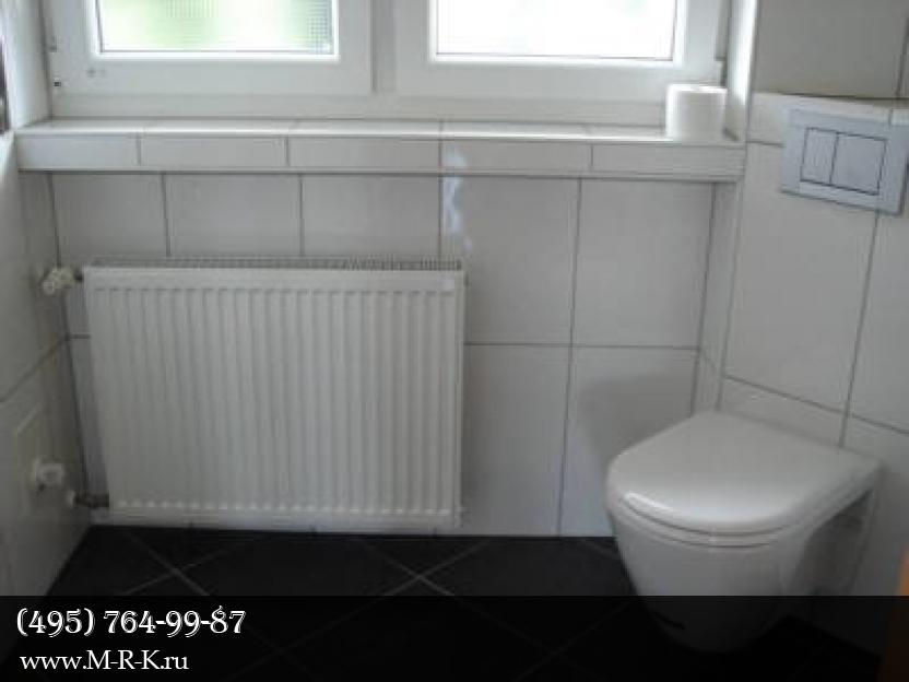 Установка радиатора отопления.